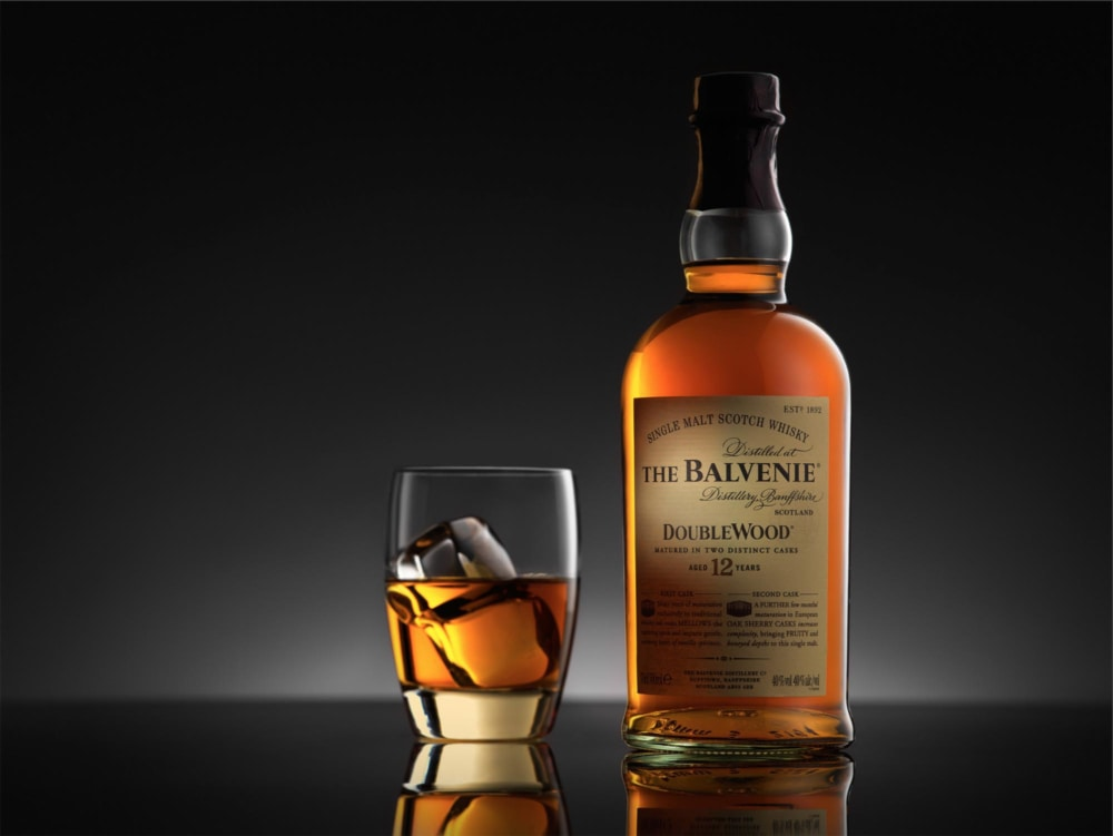 Product advertising image of whisky bottles and glass
