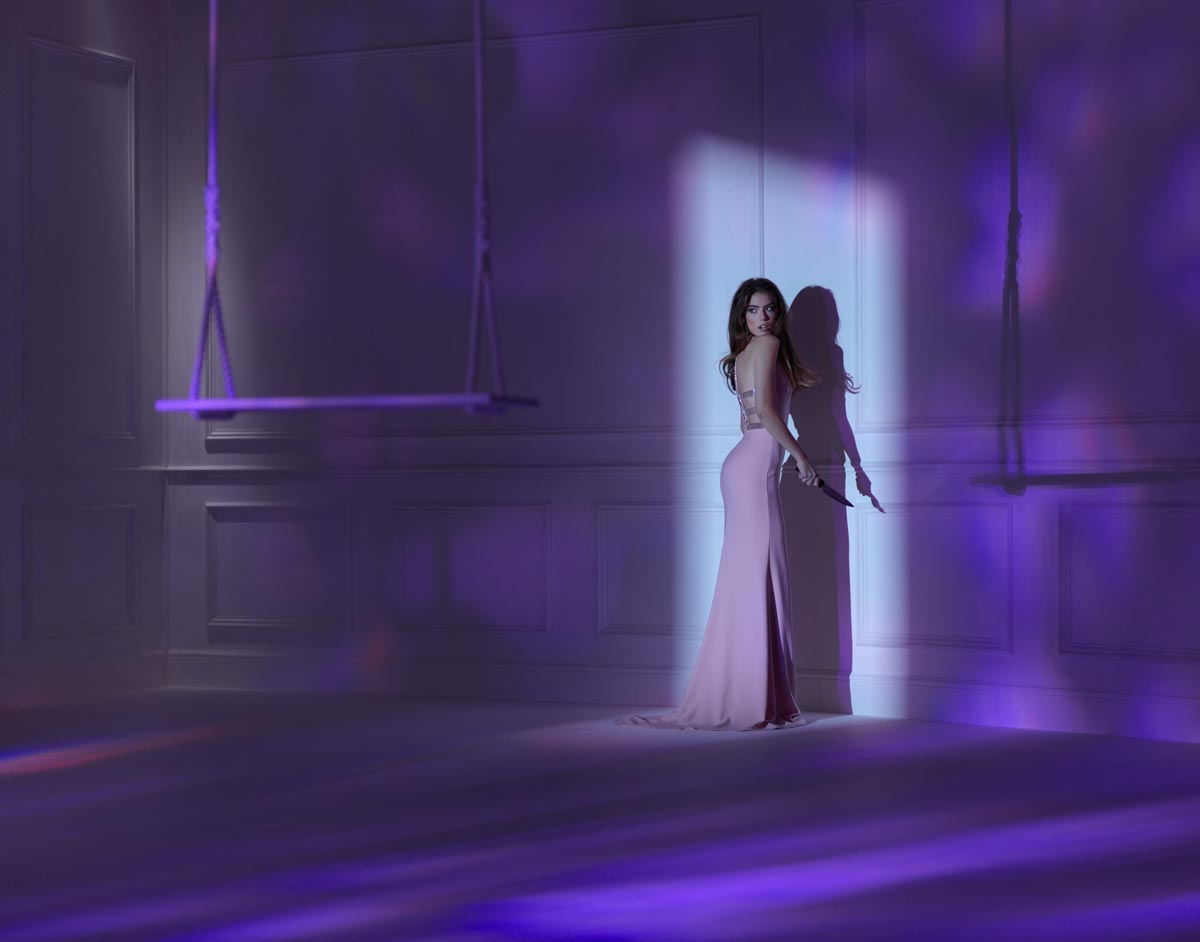 Fashion photo of girl in light of door - by Karl Taylor